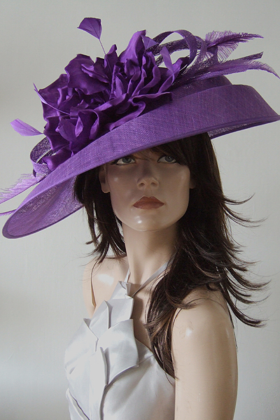 Peter Bettley Mother of The Bride Hat Hire. Purple Mother of the Bride Hat 2021. Big Purple Hat for Royal Ascot. Wedding Hat Hire UK.