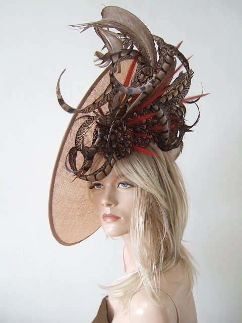 Big Feather Hats for Royal Ascot 2021. Royal Ascot Hat Rental 2021. Hat Hire Berkshire. Best Royal Ascot Hats 2021. Ladies Wedding Hats for Hire 2021. Big Nude colour Fascinators. Royal Ascot Hat Rental 2021. Big Hats to wear for the races. Formal Wedding Hats for Hire UK 2021. Hats for the Races 2021.