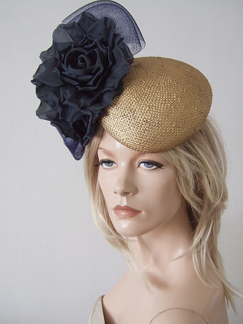 Navy and Gold Formal Hat. Navy Gold Hat for Royal Ascot 2021. Royal Ascot Hat Rental 2021. Hat Hire Berkshire. Navy and Gold Wedding guest hats 2021. Hats for Hire 2021. Navy and Gold Mother of the Bride Hat 2021. Royal Ascot Hat Rental 2021. Wedding Hats for Hire UK 2020. Hats for Cheltenham Races 2021. Hats for the Races 2020.