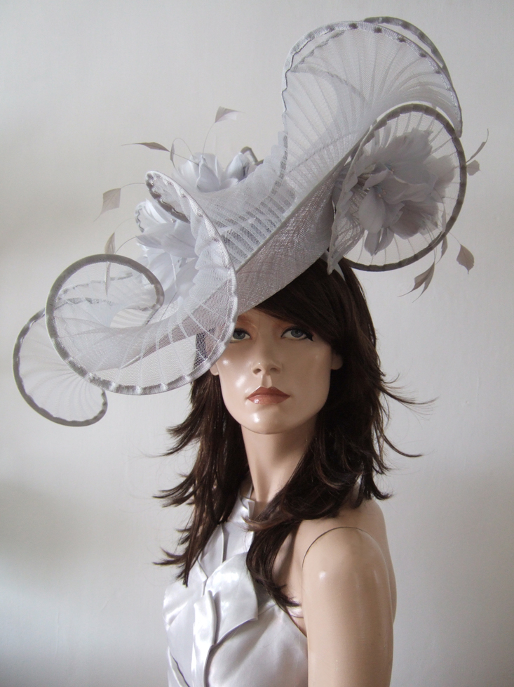 Silver Designer Hats for Hire near London. Royal Ascot Hat Rental 2021. Hire Hats for Wedding Guests UK. Best Royal Ascot Hats 2021. Designer Hats for Hire 2021. Silver Hats for Royal Ascot 2021. Hats to wear with a Silver dress. Wedding Hats for Hire UK 2020. Amazing Hats for the Races 2021. Silver Mother of the Bride Hat Hire 2021.