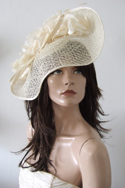 Ivory Wavy Hat. Ascot Hat Hire. Mother of the Bride. www.dress-2-impress.com London Hat Hire. Ascot Hats