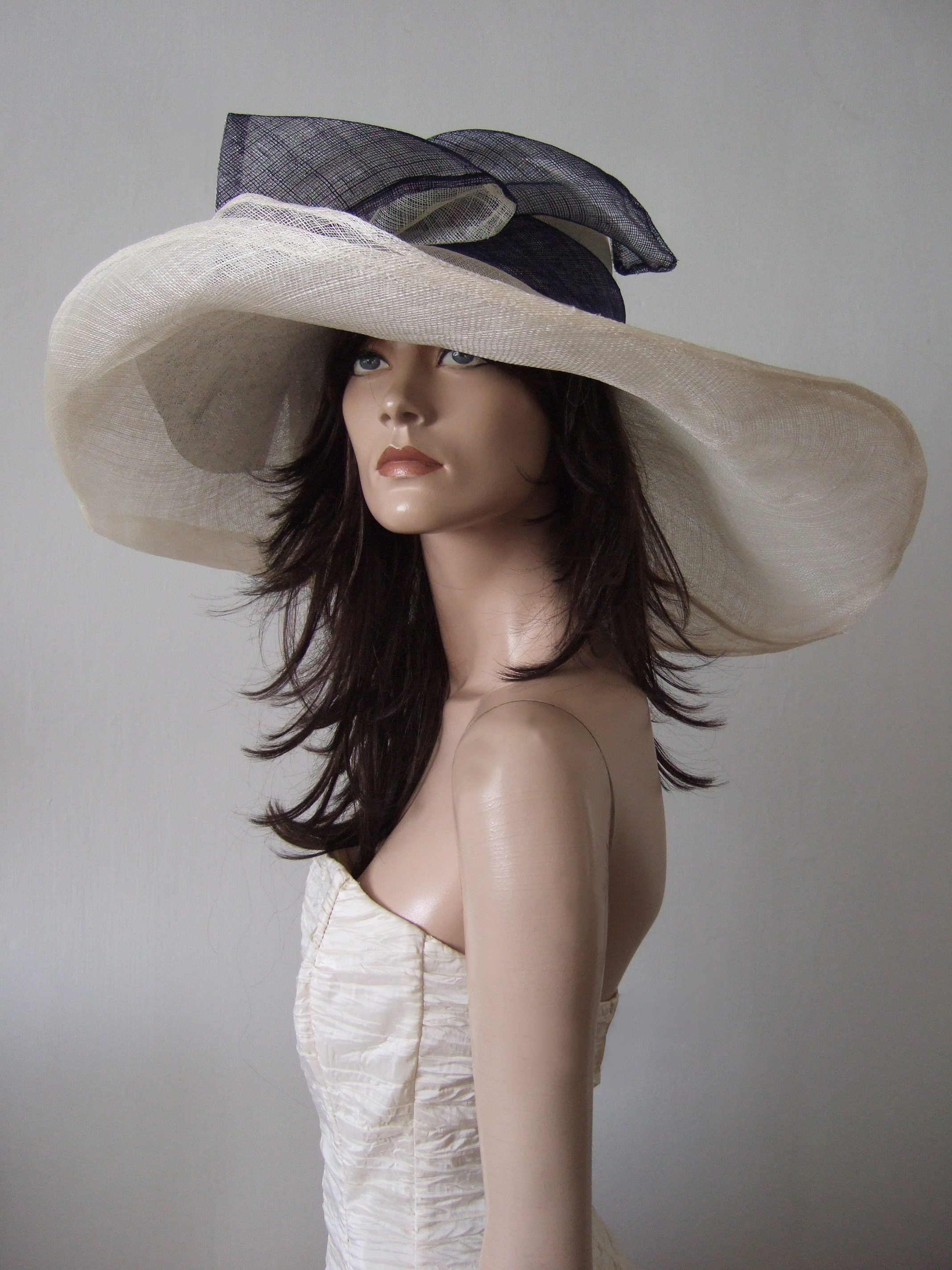 Ivory Formal Wedding Guest Hats 2021. Ivory and Navy Hats for Royal Ascot 2021. Big Royal Ascot Hats 2021, Formal Hat Hire 2020. Hat Hire Berkshire. Wedding guest hats 2020. Hats for Hire 2020. Ladies Wedding Hats 2021. Big Mother of the Bride Hats 2021. Royal Ascot Hat Rental 2021. Wedding Hats for Hire UK 2020. Hire Hats for Epsom Races 2020.