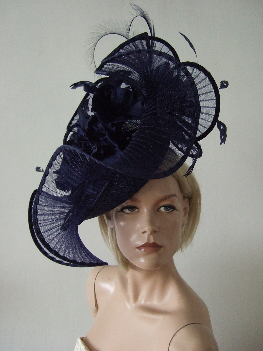 Navy Designer Hats for Hire near London. Royal Ascot Hat Rental 2021. Hire Hats for Wedding Guests UK. Best Royal Ascot Hats 2021. Designer Hats for Hire 2021. Navy Floral Fascinators. Hats to wear with a Navy dress. Wedding Hats for Hire UK 2021. Amazing Hats for the Races 2021. Navy Blue Mother of the Bride Hat Hire 2021.