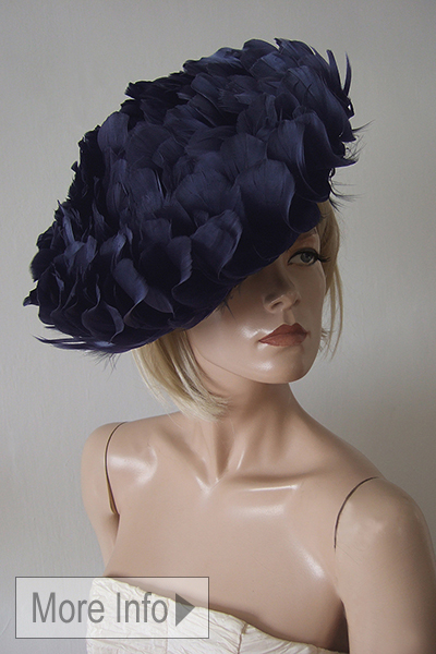 Navy Feather Disc Hat. Royal Ascot Hat Hire. Amazing Hats for Royal Ascot. Mother of the Bride Hats. Navy Mother of the Bride Hats. What to wear for Royal Ascot