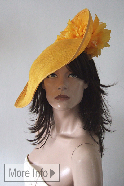 Yellow Slice Saucer Flower Headpiece Hat. Yellow Hats for the Races. Ascot Hat Hire. Mother of the Bride Hats. London Hat Hire. Hat Hire Berkshire.