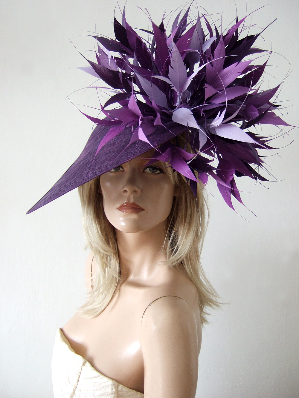 Designer Hats for Hire London. Hostie Hats 2021. Hostie Hats Bamburgh Dish Hat. Mother of the Bride Hats 2021. Hats for Wedding Guests UK. Best Royal Ascot Hats 2021. Designer Hat for Hire 2021. Wedding Hats for Hire UK 2021. Big Purple Hats for the Races. Mother of the Bride Hat Hire 2021. Big Purple Wedding Guest Hats.